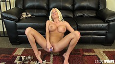 The busty blonde licks a purple dildo before inserting it deep in her snatch